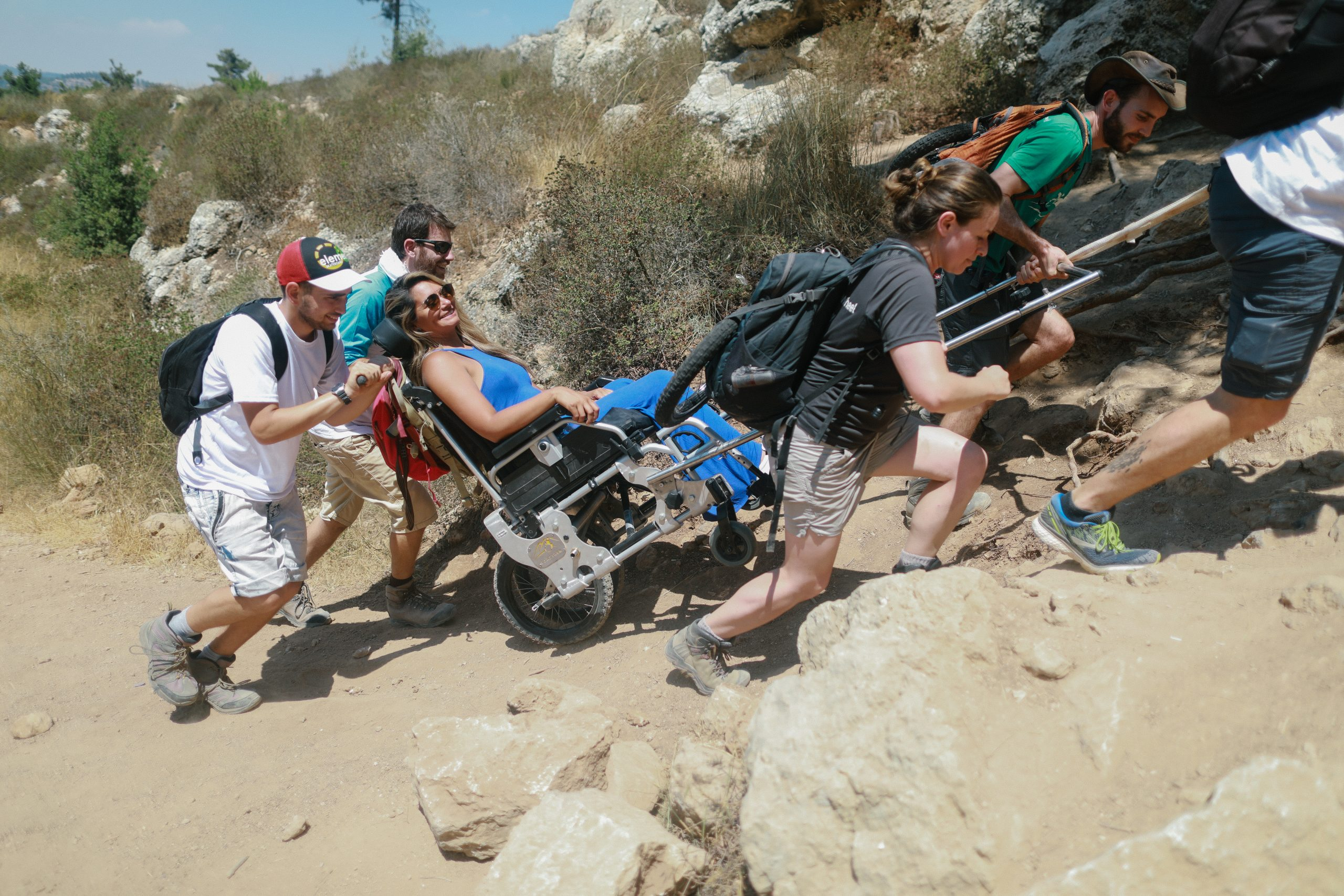 """<img src=""""Hikers assisting someone in a Trekker.jpg"""" alt=""""Group of hikers helping to get someone in a Trekker up a slope"""">"""