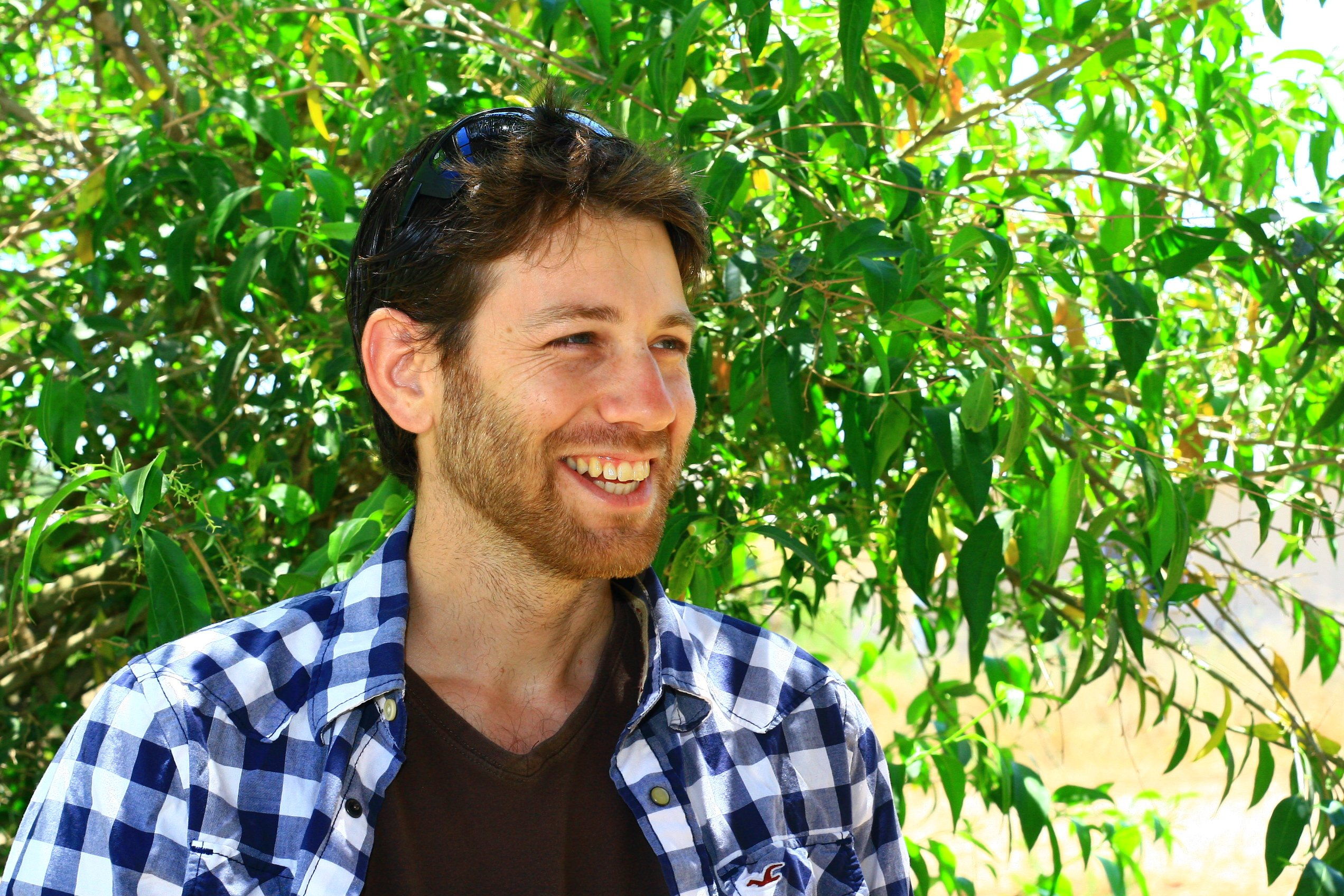 """<img src=""""Omer Zur.jpg"""" alt=""""Photo of a smiling Omer Zur wearing a blue and white shirt standing in front of a tree with green leaves"""">"""